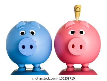 Two cute piggy banks with Australian dollars in one of them. Isolated on white.