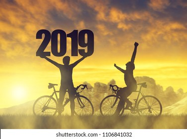 Two cyclist with bicycle at sunset. Forward to the New Year 2019.