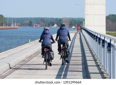 Two cyclists crossing the trough bridge over the River Elbe at Hohenwarthe in Germany