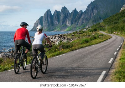 two cyclists relax biking in Norway