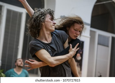 two dancers improvise in contact. Contemporary dance performing