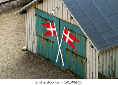 Two Dannebrog, danish ensign, painted on an old garage gate