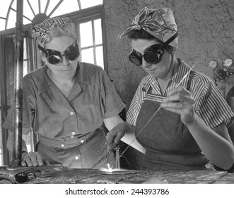 Two Daytona Beach, Florida, housewives welding in an Aircraft construction class during World War II. Both have sons in the military. April 1942.