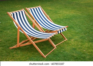 The two deck chairs on the lawn
