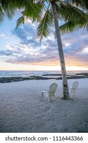 Two deck chairs under palm tree on an empty beach at Lefaga, Matautu, Upolu Island, Western Samoa, South Pacific - portrait orientation