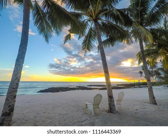 Two deck chairs under palm trees at sunset on an empty beach at Lefaga, Matautu, Upolu Island, Western Samoa, South Pacific