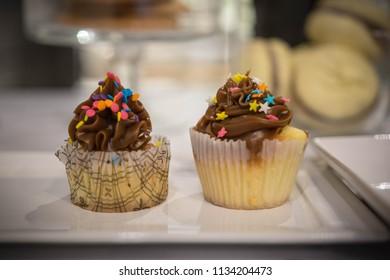 Two decorated cupcakes