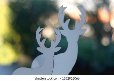 Two deer figures, minimal Christmas decoration. Selective focus, beautiful bokeh.
