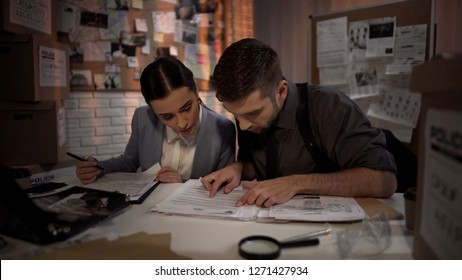Two defense lawyers working overnight and finding answer in top secret files