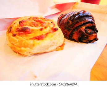 Two delicious breads (Croissant and side dish bread)