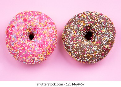Two delicious Donut on pink Background