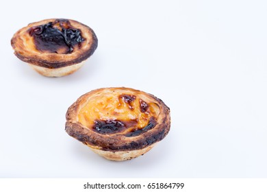 Two delicious egg tart pastry - Pastel de Nata from Portugal isolated on white background