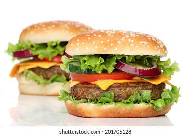 Two delicious hamburgers isolated on white background