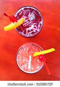 Two delicious sangria cocktails on a bar table.