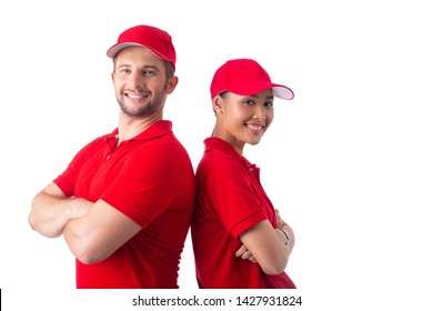 Two delivery people posting in studio with white background.