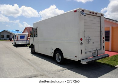 Two Delivery Trucks [all brand names removed]