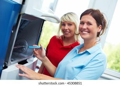 Two Dental technicians with a CAD/CAM sytem