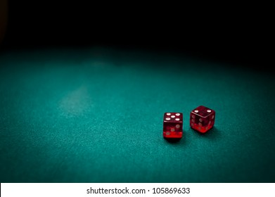 Two dice counting seven on a card table