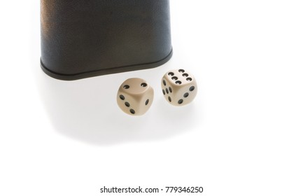 Two dice and one dice cup - isolated on white