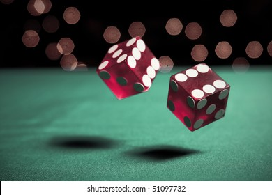 two dice rolling on table