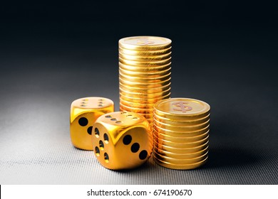 Two dice and stacks of gold coins. 3D illustration on dark background.