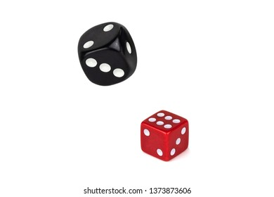 Two dices isolated on white. Red lies like six with a shadow, black in flight.