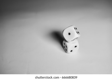 Two dices piled (more to the right)