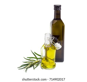 Two different glass bottles of the olive oil and olive branch beside on a white background