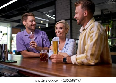 two different guys liked one girl at bar, want to draw attention to themselves, smile