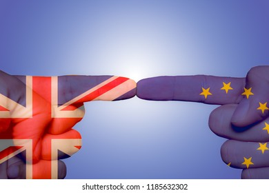 Two different hands touching each other by index finger. UK union jack and EU flags in each hand, symbolizing brexit concept
