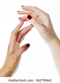 two different nathion manicured hands on white isolated, african