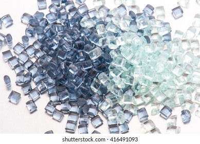 two different polymer plastic granulates on white background