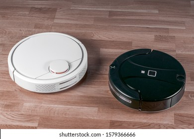 two different Robotic vacuum cleaners. concept choosing household helper. modern smart appliance for cleaning house.