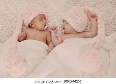 two different twins are sleeping on the bed