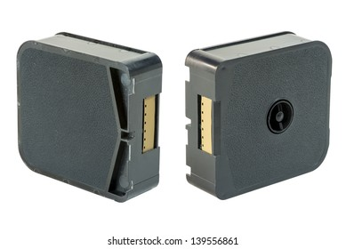 Two different views of an old super 8 film cartridge, isolated over white with clipping paths.