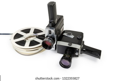 Two different vintage amateur film movie cameras and reels of color motion picture films Super 8mm format close-up on a white background