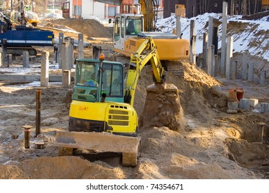 Two diggers in the building construction.