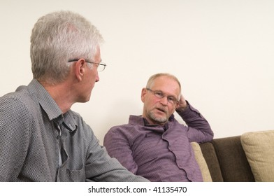Two discussing seniors at home.