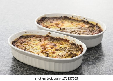 Two dishes of bobotie already baked and  ready to eat