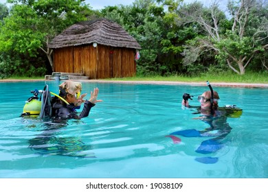 Two divers exercising in training pool. Shot in Sodwana Bay, KwaZulu-Natal province, Southern Mozambique area, South Africa.