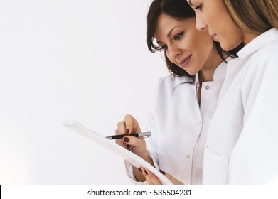 Two doctors discussing medical issues on a medical council.