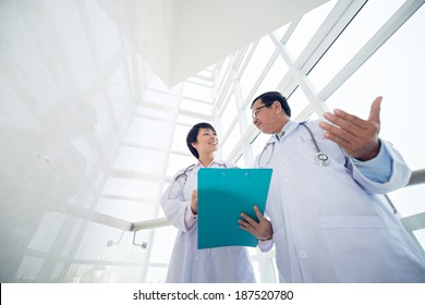 Two doctors discussing results of the analysis