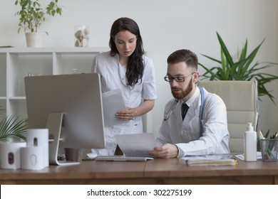 Two doctors discussing test results and working together