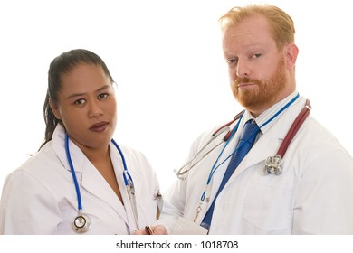 Two doctors - man and woman - diverse.  Focus on man