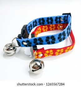 Two dog pet cat collar with a little bell on white background.