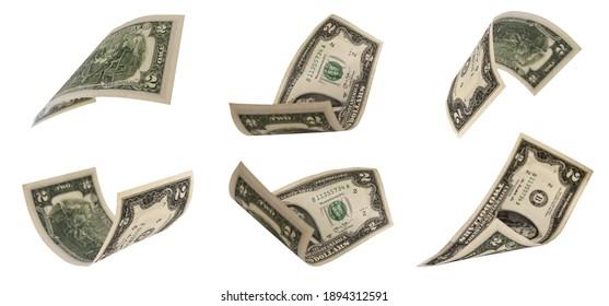 Two dollar banknotes isolated on a white background. A lot of bills in a chaotic order lie on a white background.