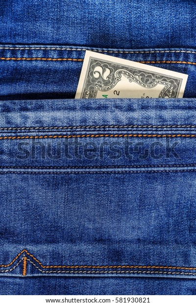 Two dollar bill in the pocket of  blue jeans. Cash money.