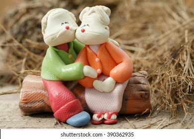 Two Dolls grandfather and grandmather hug and holding Love Heart