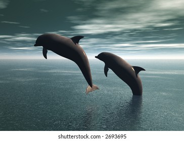 Two dolphins jumping and playing in the ocean
