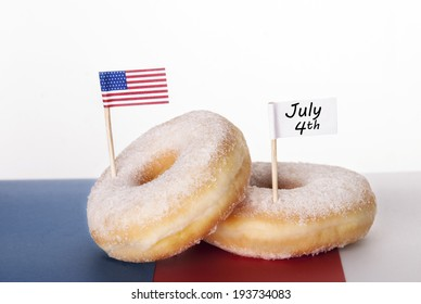 Two Donuts with American Flag and white Banner with July 4th, Isolated